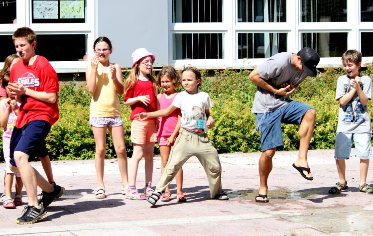 Americans get hit with water balloons as Czech children dance (literally break down) with delight.
