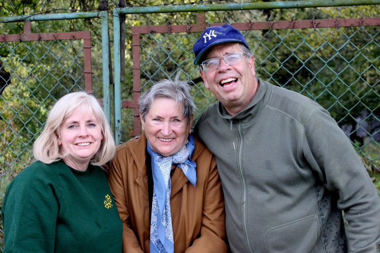 Marilyn, Miluška and Jerry in front of the orchard gate.