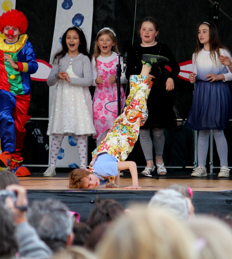 The little clown break-dancing there is in 2nd grade. Talent, folks. Read talent.