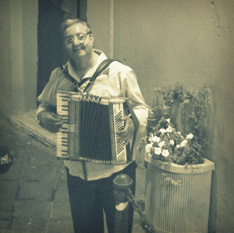 The man playing accordion outside my window.